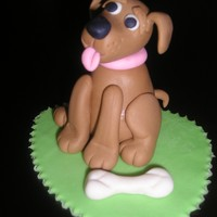 Dixie   Here I tried my hand making a gumpaste dog taught by Lorraine McKay on YouTube Love your tutorials.