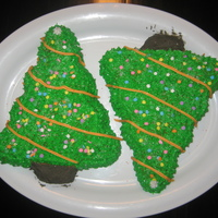 Christmas Tree Cakes Piped Christmas tree cakes I made for my sons class.