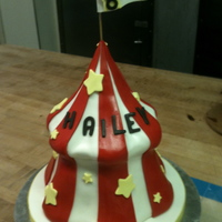 Circus Tent Cake Made using the giant cupcake pans and carved down to make a pointed top. Covered the top with fondant first then the rest after.