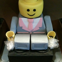 "Lego Man Groom's cake made for a Pink & Grey themed wedding. 8"" black lego block with lego man sitting on top. All cake, except RKT..."