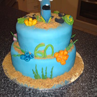 Dory  This was for my sisters MIL her 60th.I did Dory from finding nemo because she is like the fish with a 2 second memory.The cake is 2 tied...