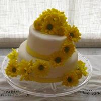 Yellow Daisy Bridal Shower Cake  This was my first two tier cake!! i made this for my good friends bridal shower and everyone said it was the best tasting cake they have...