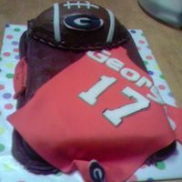 Georgia Cake doctored white cake mix, hershey's cocoa icing. The football is made from rice krispie treats; jersey, letters & emblems are...
