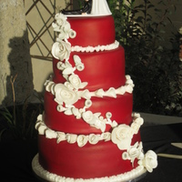 My First Wedding Cake Red Velvet Cake with fondant and fondant accents. Thank you to my friends for allowing me the opportunity to make my first wedding cake...