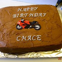 "Nephews Motorcycle Cake  Made this for my Nephew""s 27th Birthday. . He race's motorcycles. So I put the one that he race's on his cake. A Man cake....."