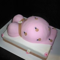 Prego Belly  Pink/Brown lady bugs @ clients request.. belly is choco base in vanilla.. all fondant covered.. flowers are sugar bought from my local...