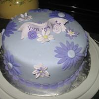 Birthday Cake Purple fondant with gumpaste flowers.