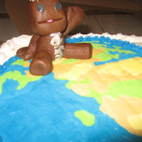 Little Big Planet Birthday Cake FBCT planet, Fondant/gumpaste Sackboy, WASC cake w/Strawberry Dreamwhip White Chocolate filling. BC frosted.