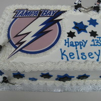 2Nd Lightning Hockey Birthday Cake   Edible image. Fondant stars. Figures are plastic. Cake is doctored white with cookies n cream filling and BC frosting.