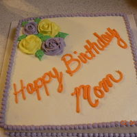 Mom Cake   A quick cake for my mother-n-law. First time doing roses on a cake. Pina colada cake with coconut flavored buttercream icing. Yummy!