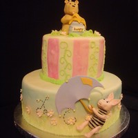Winnie The Pooh Baby Shower Cake Winnie the Pooh baby shower cake. Got the idea from http://staceyssweetshop.blogspot.com/2009/07/classic-pooh-baby-shower-cake.html just...
