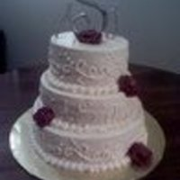 Wedding Cake For 9-11-2010   Lemon cake with raspberry bc filling and ivory bc. Scroll design and bc roses. Thanks for looking!