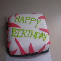 Pink Zebra Cake White cake covered in white fondant with hot pink zebra stripes. Black ball fondant boarder with happy birthday written in lime green BC.