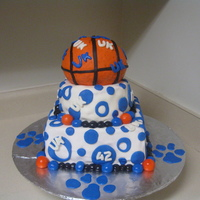 University Of Kentucky Wildcats Cake This cake is a UK themed birthday cake. Cake is red velvet with cream cheese icing. The basketball is the sports ball pan.
