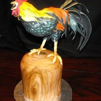 Cock-A-Doodle-Doo! Rooster body is RKT covered with fondant/gumpaste feathers. Stump is french vanilla cake covered in fondant.