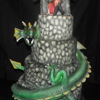 Dark Fairy And Her Pet Covered in fondant, with hand-carved cobblestone. Dragon and fairy throne are RKT covered in gum paste/fondant mix. All details hand...