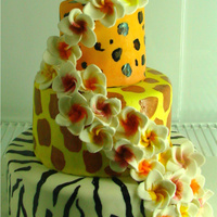 Animal Print Plumeria Birthday Cake   hand painted animal print...sugarpaste plumeria flowers with luster dust