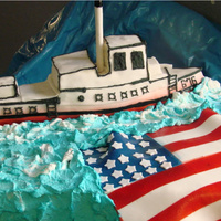 Navy Birthday Cake   Made for an 80th bday cake...ship was made to resemble the Navy ship he served on...the ship and water are cake,,,
