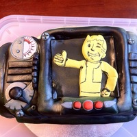 Pip-Boy This is from the video game fallout. I made it for my husbands birthday. It is homemade marshmallow fondant and all pieces are handmade and...