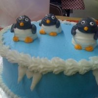 Icy Cold I needed to find something more creative than the Wilton clowns to pipe for my Course 1 cake, so I decided to pipe penguins and it worked...