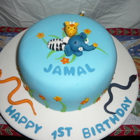 1St Birthday Fondant covered with hand-made animals and elements.