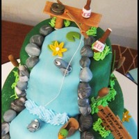 Fishing Scene  Made this for my dad's retirement party. I wish I was good with sculpting I would have tried to make my dad actually fishing, but oh...