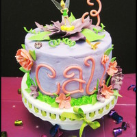 Tinkerbell Birthday This cake was for my niece's 3rd birthday. She loves Tinkerbell! Vanilla cake with vanilla crusting buttercream frosting. All the...