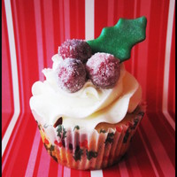 Winter Holly Cupcakes  These are cran-orange cupcakes with white chocolate SMBC topped off with sugared cranberries and a fondant holly leaf. http://caralee83....