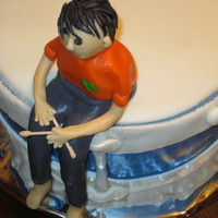 Drummer Boy   This cake was made for a best friend's birthday boy...This is my first fondant person.