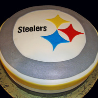 Pittsburgh Steelers Logo Cake Chocolate cake filled and coated in chocolate ganache, then covered in fondant.