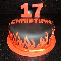 Christian's Birthday Cake This cake was made for a 17 year old boy. I was told to use the number 17 and red & black. It is WASC with chocolate chips. TFL!