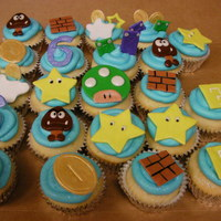 Super Mario Galaxy Cupcakes   These cupcakes are joined with the super Mario Galaxy cake