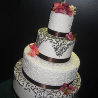 Brown Filigree 4 tier white wedding cake with alternating brown and white filigree tiers