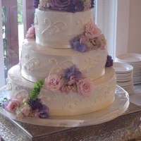 White Wedding Cake With Fresh Flowers 3 tier white buttercream cake with scroll design and fresh flowers cascading downwww.sugarnspicepatisserie.com