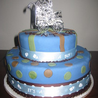 Blue & Brown Boy Baby Shower This is a 2 tier blue and brown baby shower cake for a boy with a silver carriage on top. www.sugarnspicepatisserie.com