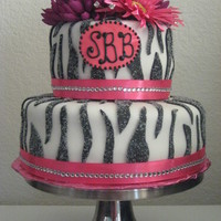 Zebra Print Cake Zebra baby shower cake with sugared zebra stripes and flower accentswww.sugarnspicepatisserie.com