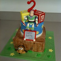 Toy Story Bottom tier is chocolate cake with peanut butter filling, second tier is French vanilla with cappuccino filling and the top two blocks are...