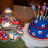 4Th Of July Cake   My second time doing a two tiered fondant cake. Cupcakes were from extra batter from top tier,