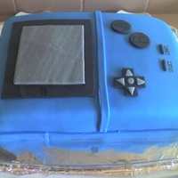Gameboy Cake This cake is made for my brother's 20th birthday. Everyone at the party loved it including him =)