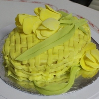 Yellow Tulips On A Basket White cake with yellow buttercream basket weave and yellow gum paste tulips and leaves.