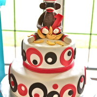 Sock Monkey Cake Chocolate cake with banana cream cheese filling, frosted with ganache under fondant.