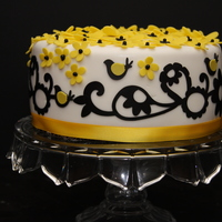 My First Cricut Cake  Black and yellow color scheme for my daughter's 29th birthday. She loves doves and her favorite number is 7 so I incorporated 7 doves...