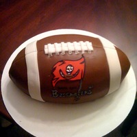 Bucs Football Chocolate fudge cake covered in homemade chocolate fondant. The logo and wording are gumpaste. I must say that the Tampa Bay BUCS have the...