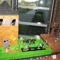 Animated, Moving Halloween Cake This is a Halloween cake that I made for a kids Halloween party at my husbands work. It's got moving hands in the graveyard, spinning...