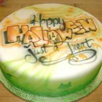 Airbrushed Fondant Cake,fancy Halloween Lettering. This is a fondant cake that has been based Airbrushed a marble texture on sides with cat and bat motifs, and bubble lettering with detailed...