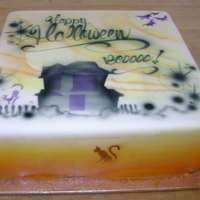 Airbrushed Fondant,halloween Theme This is a detailed Airbrush Fondant cake with a multi-coloured fade on sides and, cat and witch motifs on sides, a Haunted house and fancy...