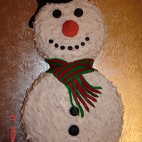 Snowman This was my first attempt at a snowman cake, he is covered in royal icing sprinkled with sparkles and has fondant features