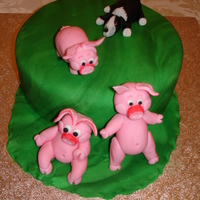 Pig Chase My first attempt at moulding animals for a friends Birthday cake and animals are both fondant