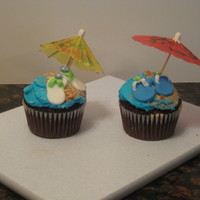 Summer Beach Cupcakes Chocolate cupcakes with vanilla buttercream and fondant sandals and beach balls.