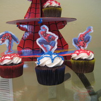 Spiderman Cupcakes Chocolate cupcakes with blue and red webs and Spiderman toppers.